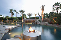Palm Springs swimming pool with live flame heater