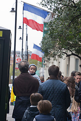 © licensed to London News Pictures. London, UK 06/05/2012. A family walking to the end of the queue as French nationals queueing outside the French Embassy in London to vote the second round of Presidential Elections, this noon (06/05/12). Photo credit: Tolga Akmen/LNP