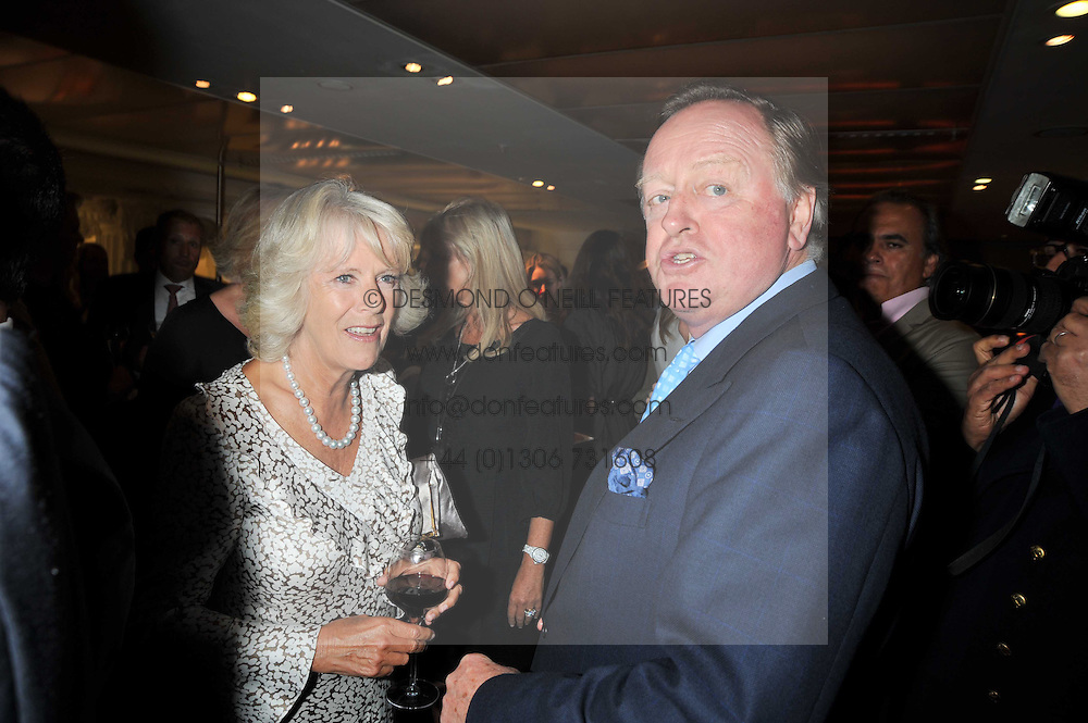 HRH The DUCHESS OF CORNWALL and her ex husband ANDREW PARKER BOWLES at the launch of Tom Parker Bowles's new book 'Full English' held in the Gallery Restaurant, Selfridges, Oxford Street, London on 9th September 2009.