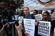 'Refugees Welcome Here' <br /> National demonstration called in solidarity with refugees fleeing the crises in Syria and North Africa.<br /> March from Marble Arch to Downing Street London.<br /> Peter Tatchell, human rights activist being interviewed.