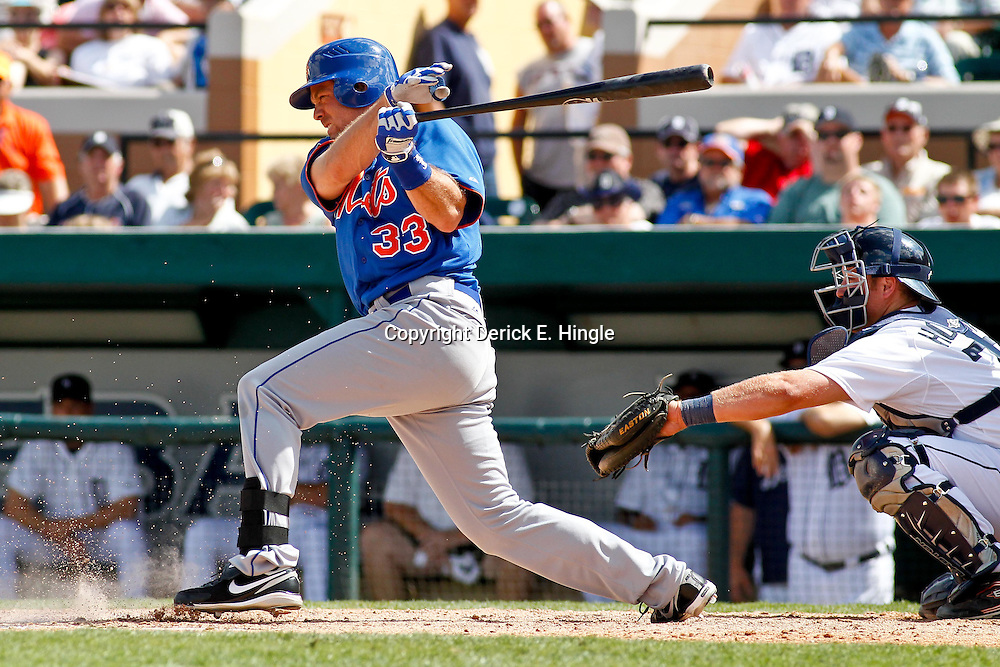 March 14, 2012; Lakeland, FL, USA; New York Mets relief pitcher Taylor Buchholz (33) against the Detroit Tigers during a spring training game at Joker Marchant Stadium. Mandatory Credit: Derick E. Hingle-US PRESSWIRE