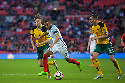 LONDON, ENGLAND - Sunday, March 26, 2017: England's Ryan Bertrand in action against Lithuania's Artūras Žulpa and Egidijus Vaitkūnas during the 2018 FIFA World Cup Qualifying Group F match at Wembley Stadium. (Pic by Xiaoxuan Lin/Propaganda)