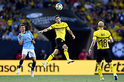 July 20, 2018 - Chicago, IL, U.S. - CHICAGO, IL - JULY 20: Borussia Dortmund midfielder Christian Pulisic (22) heads the ball during an International Champions Cup match between Manchester City and Borussia Dortmund on July 20, 2018 at Soldier Field in Chicago, Illinois. (Photo by Robin Alam/Icon Sportswire) (Credit Image: © Robin Alam/Icon SMI via ZUMA Press)