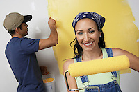 Couple Painting Room Yellow