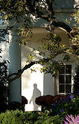 U.S. President George W. Bush casts a shadow as he walks out of the west wing of the White House in Washington DC USA on 02 November 2007. Bush is traveling to South Carolina today to campaign for a republican senate candidate and meet with some troops.