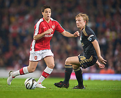 LONDON, ENGLAND - Wednesday, October 28, 2009: Liverpool's Dirk Kuyt and Arsenal's Samir Nasri during the League Cup 4th Round match at Emirates Stadium. (Photo by David Rawcliffe/Propaganda)