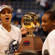 Skylar Diggins, Notre Dame, (left) and Jewell Loyd, Notre Dame,  with the trophy after the Connecticut V Notre Dame Final match won by Notre Dame during the Big East Conference, 2013 Women's Basketball Championships at the XL Center, Hartford, Connecticut, USA. 11th March. Photo Tim Clayton