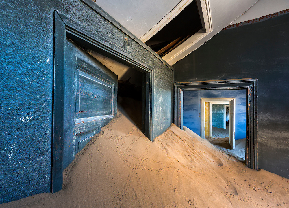 Sand invades abandoned houses in Kolmanskop, Namibia.