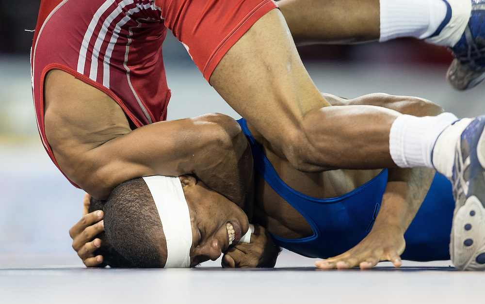 Jansel Ramirez  (top) of the Dominican Republic tries to get leverage on Andres Montano of Ecuador during their quarter final bout in the 59kg class of the men's greco-roman wrestling  at the 2015 Pan American Games in Toronto, Canada, July 15,  2015.  AFP PHOTO/GEOFF ROBINS