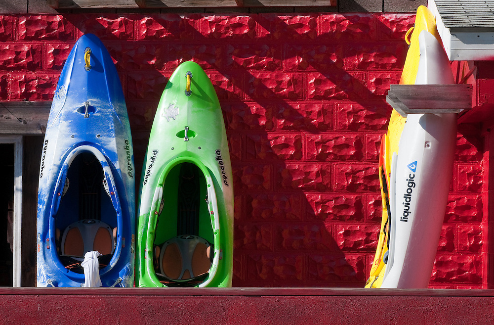 Kayaks leaning against building wall