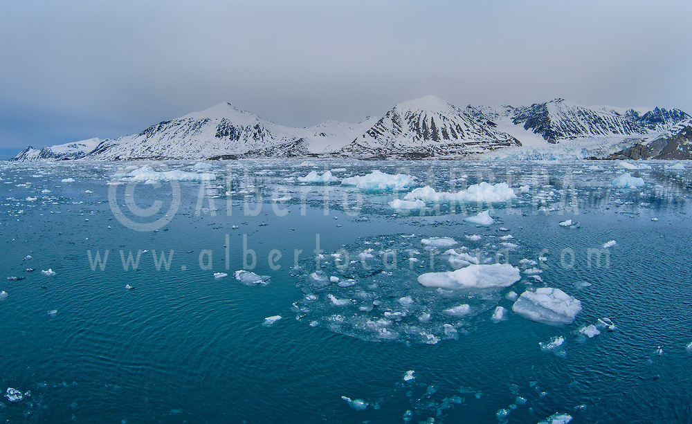Alberto Carrera, Arctic Lands, Drift floating Ice and Snowcapped Mountains, Iceberg, Ice Floes, Albert I Land, Arctic, Spitsbergen, Svalbard, Norway, Europe