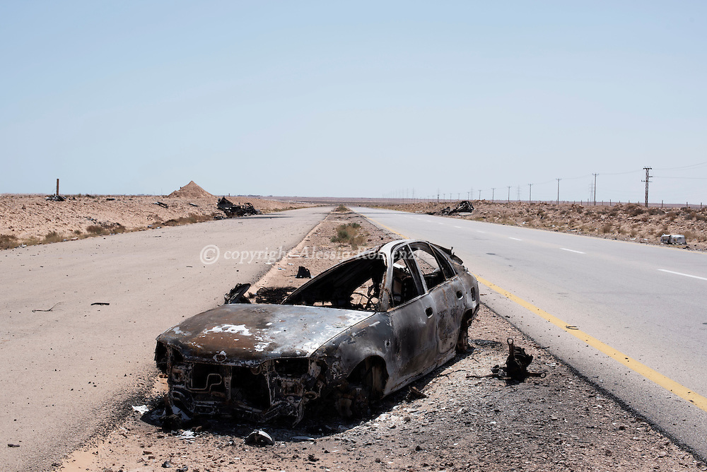 Libya: Destroyed car on the road between Misurata and Sirte. Alessio Romenzi