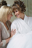 Mother talking to daughter in bathrobe