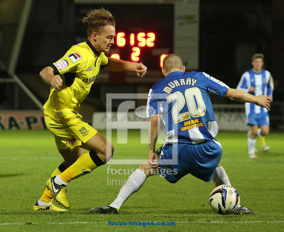 Picture by Paul Gaythorpe/Focus Images Ltd +447771 871632.07/11/2012.Adam McGurk of Tranmere Rovers and Paul Murray of Hartlepool United during the npower League 1 match at Victoria Park, Hartlepool.