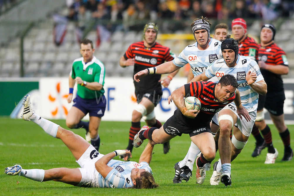 Dimitri Szarzewski of Racing Metro 92 (L) tackles Brad Barritt of Saracens (R) during the Heineken European Rugby Cup Pool 1 match between Saracens and Racing Metro 92 at King Baudouin stadium in Brussels, Belgium, 20 October 2012.