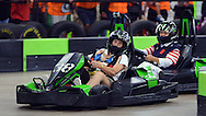 HORSHAM, PA - AUGUST 22: Esther Siegle (L), 80, of Norristown, Pennsylvania passes Mary Bodenstine (R), 76, of Folcroft, Pennsylvania during the final heat of the Granny Grampy Grand Prix at Speed Raceway August 22, 2014 in Horsham, Pennsylvania. Grandparents competed in electric go cart races to win a trip for four to Florida for the grandchild that entered them into the contest, which was sponsored by radio station WMMR. (Photo by William Thomas Cain/Cain Images)