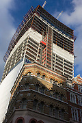 New Tower block rises above a Victorian office block in the City of London.