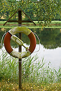 A life preserver is close at hand at the edge of a section of water near the island of Jordö, one of many in the southern archipelago near Karlskrona, Sweden. Like most of the islands in the area, Jordö sees its population increase dramatically during the summer months as Swedes flock to their cottages to enjoy the short but sweet summer period.