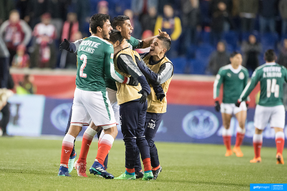 HARRISON, NEW JERSEY- APRIL 10: Carlos Salcido #3 of C.D. Guadalajara and Oswaldo Alanis #2 of C.D. Guadalajara celebrate with team mates after the final whistle during the New York Red Bulls Vs C.D. Guadalajara CONCACAF Champions League Semi-final 2nd leg match at Red Bull Arena on April 10, 2018 in Harrison, New Jersey. (Photo by Tim Clayton/Corbis via Getty Images)