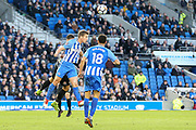 Brighton and Hove Albion defender Uwe Huenemeier (4) heads clear during the The FA Cup match between Brighton and Hove Albion and Coventry City at the American Express Community Stadium, Brighton and Hove, England on 17 February 2018. Picture by Phil Duncan.