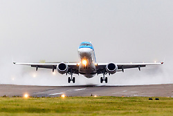 © Licensed to London News Pictures. 10/08/2018. Leeds UK. A KLM aircraft takes of in the rain this morning at Leeds Bradford International Airport as heavy rain is expected over the weekend in Yorkshire. Photo credit: Andrew McCaren/LNP