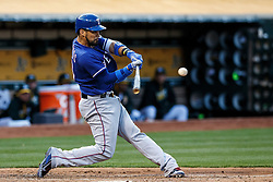 OAKLAND, CA - JUNE 14:  Robinson Chirinos #61 of the Texas Rangers hits a three run home run against the Oakland Athletics during the second inning at the Oakland Coliseum on June 14, 2016 in Oakland, California. (Photo by Jason O. Watson/Getty Images) *** Local Caption *** Robinson Chirinos