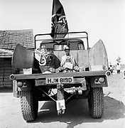 Man and child sitting on the back of Emma's truck, Glastonbury, Somerset, 1989