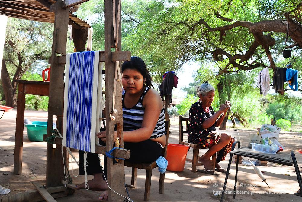 Guarani girl weaving