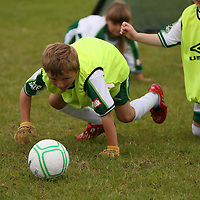 Sean Purtell scrambles for the ball at the FAI summer soccer camp in Gallery Park in Kilrush during the week.<br /> Photograph by Yvonne Vaughan