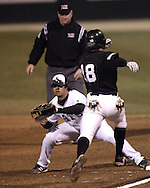 Kansas State first basemen Cris Tapia stretches out, to force out Wichita State's Damon Dublett (18) in the top of the first inning.  K-State defeated the 19th ranked Shockers 6-3 at Tointon Stadium in Manhattan, Kansas, March 14, 2006.
