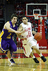 29 December 2011:  Nic Moore charges past the 3 point arc as Matt Morrison attempts to slow him down during an NCAA mens basketball game between the Northern Illinois Panthers and the Illinois State Redbirds in Redbird Arena, Normal IL