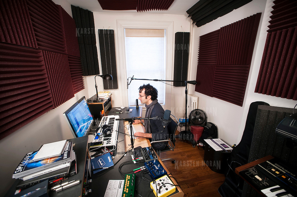 April 4, 2013 - Brooklyn, NY :  Jad Abumrad, co-host of the WNYC / NPR program 'Radiolab', works from his home office in Fort Greene, Brooklyn, two days a week where he does most of the sound design and scoring for the program. Pictured here, Jad is seen working at his desk in his home office on Thursday morning.  CREDIT: Photo by Karsten Moran for Macworld Magazine / IDG Consumer & SMB