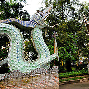 Sculptures of two dragon serpents at the entrance to the Hanoi Botanical Gardens (Vuon Bach Thao). The scales are created by porcelain plates.