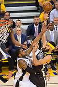 Golden State Warriors center JaVale McGee (1) goes to the basket against the San Antonio Spurs during Game 2 of the Western Conference Quarterfinals at Oracle Arena in Oakland, Calif., on April 16, 2018. (Stan Olszewski/Special to S.F. Examiner)
