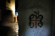 Serbian nationalist graffiti (the Serbian Cross) re-appropriated into an apple in the old town of Kotor, Montenegro..In, Around and the road to/from  Kotor, Montenegro