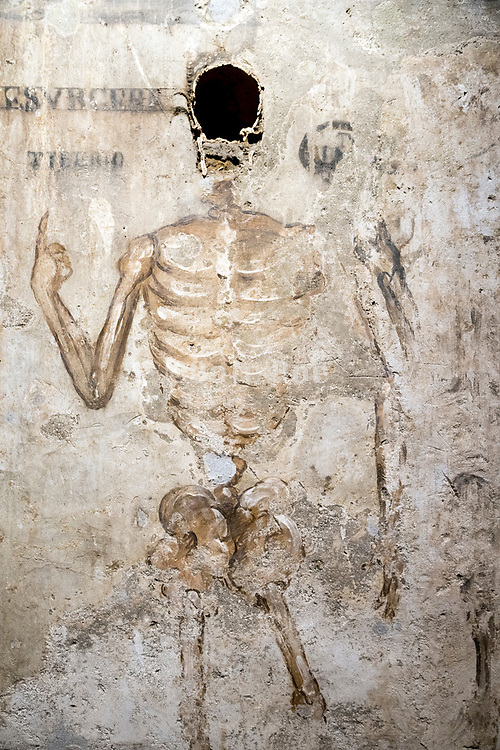 wall skeleton drawing with skull at Basilica Santa Maria del Sanita in the catacombe di san Gaudioso Naples Italy