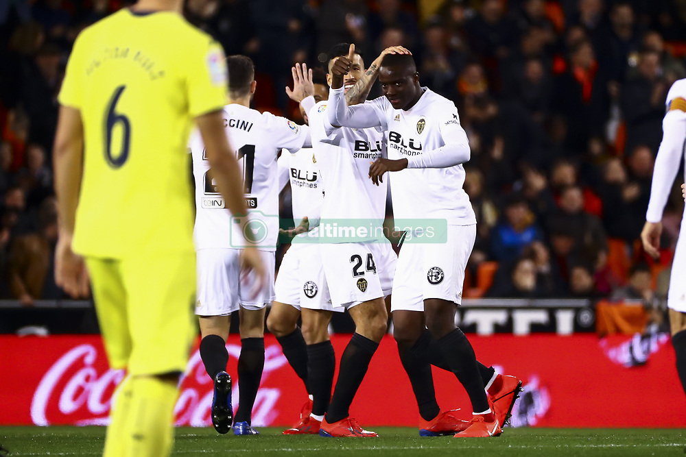 January 26, 2019 - Valencia, Spain - Mouctar Diakhaby of Valencia CF (R) celebrate after scoring the 1-0 goal with his teammate  during  spanish La Liga match between Valencia CF vs Villarreal CF at Mestalla Stadium on Jaunary  26, 2019. (Credit Image: © Jose Miguel Fernandez/NurPhoto via ZUMA Press)
