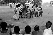 Women and children dance to traditional music in the village center.<br /> Tanlili, Burkina Faso. 09/06/2004<br /> Photo &copy; J.B. Russell