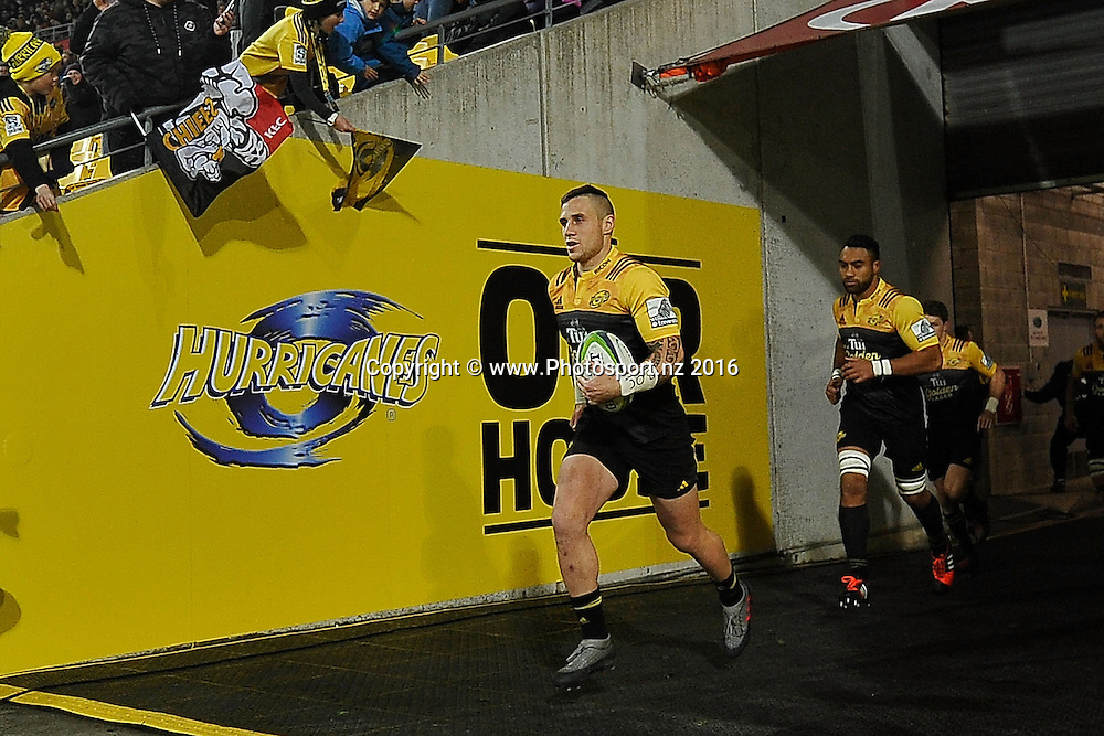 Hurricanes' TJ Perenara leads out his team during the Hurricanes vs Chiefs Super Rugby Semi Final match at the Westpac Stadium in Wellington on Saturday the 30th of July 2016. Copyright Photo by Marty Melville / www.Photosport.nz