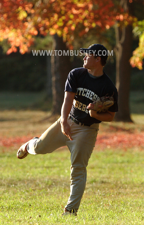 Middletown, NY -  A Dutchess County Community College baseball player warms up his arm during a fall baseball game against SUNY Orange in Middletown on Oct. 7, 2007.