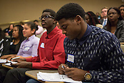 Purchase, NY – 31 October 2014. Lance Tennyson, from Port Chester High School, reviewing his notes while the team from Yonkers Montessori presents their case. The Business Skills Olympics was founded by the African American Men of Westchester, is sponsored and facilitated by Morgan Stanley, and is open to high school teams in Westchester County.