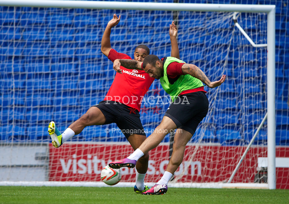 CARDIFF, WALES - Tuesday, August 13, 2013: Wales' captain Ashley Williams and Craig Davies during a training session at the Cardiff City Stadium ahead of the International Friendly match against the Republic of Ireland. (Pic by David Rawcliffe/Propaganda)