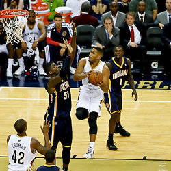 Oct 30, 2013; New Orleans, LA, USA; New Orleans Pelicans shooting guard Eric Gordon (10) shoots over Indiana Pacers center Roy Hibbert (55) during the second half of a game at New Orleans Arena. The Pacers defeated the Pelicans 95-90. Mandatory Credit: Derick E. Hingle-USA TODAY Sports