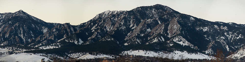 Early Morning Panorama of the Mountains and Flatirons from Boulder. Composite of 8 images taken with a Nikon D300 camera and 18-200 mm VR lens (ISO 1600, 200 mm, f/8, 1/60 sec). Raw images processed with Capture One Pro and the composite created using AutoPano Giga Pro.