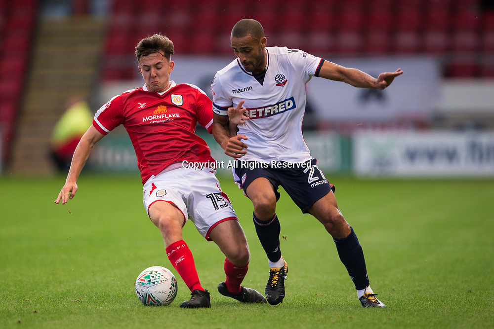 August 9th 2017, Gresty Road, Crewe, England; Carabao Cup First Round; Crewe Alexandra versus Bolton; Crewe Alexandra's Ryan Wintle and Bolton Wanderers' Darren Pratley fight over a loose ball