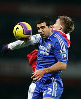 Photo: Tom Dulat/Sportsbeat Images.<br /> <br /> Arsenal v Chelsea. The FA Barclays Premiership. 16/12/2007.<br /> <br /> Nicklas Bendtner of Arsenal and Tal Ben Haim of Chelsea head for the ball.