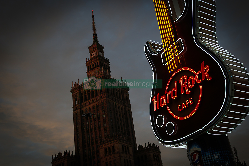 August 4, 2017 - Warsaw, Poland - A large guitar effigy decorated in neon lighting advertising the nearby Hard Rock cafe can be seen with the Palace of Science and Culture landmark in the background in Warsaw, Poland on 4 August, 2017. (Credit Image: © Jaap Arriens/NurPhoto via ZUMA Press)
