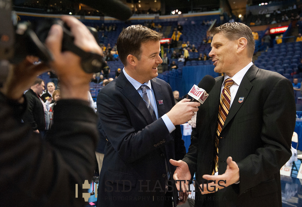 3 MARCH 2016 -- ST. LOUIS -- Loyola University Chicago's men's basketball coach Porter Moser is interviewed after the Ramblers topped Bradley University during the 2016 Missouri Valley Conference Arch Madness men's basketball tournament at the Scottrade Center in St. Louis Thursday, March 3, 2016. The Ramblers topped Bradley 74-66, to advance to the second round of the tournament.<br /> <br /> Photo &copy; copyright 2016 Sid Hastings.