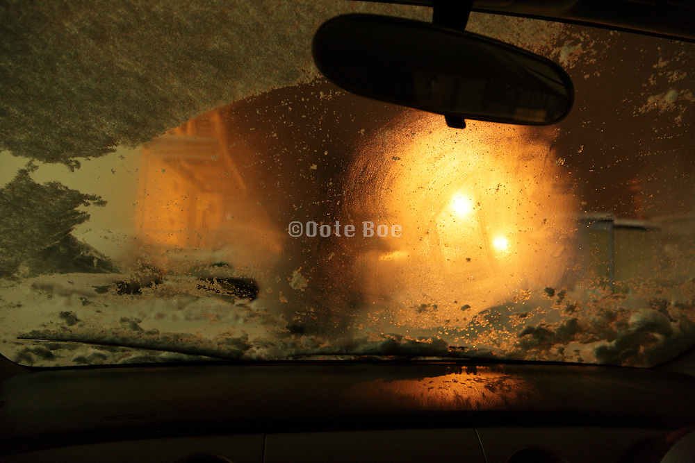 driving over a snow covered road during night