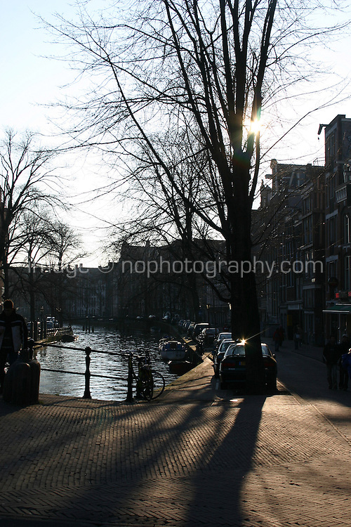 Evening sunlight by canal, Amsterdam, the Netherlands<br />